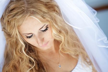 bridal hair: Beautiful bride posing in her wedding day Stock Photo