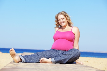 pregnant jeans: Portrait of beautiful pregnant woman at the beach