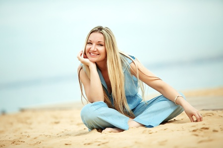 Middle aged woman resting at beach near the sea Stock Photo - 10648530