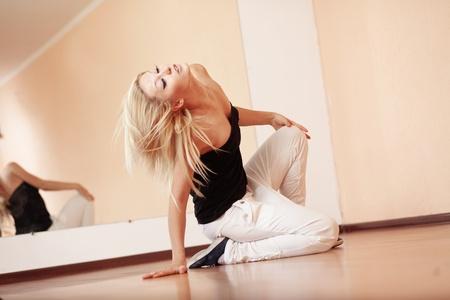 Teenage girl dancing hip-hop in gym classroom photo