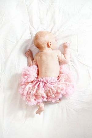 Portrait of cute newborn girl wearing pink skirt Stock Photo - 12069415