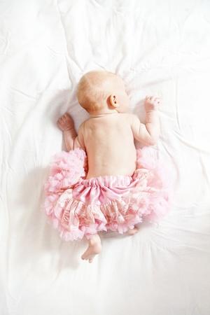 Portrait of cute newborn girl wearing pink skirt Stock Photo - 12069415