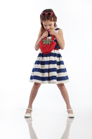 Portrait of little pin-up fashion girl sea theme photo