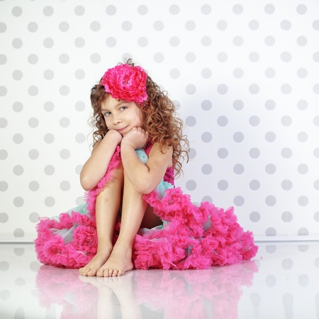 barefoot people: Studio portrait of cute little princess wearing beautiful tutu skirt