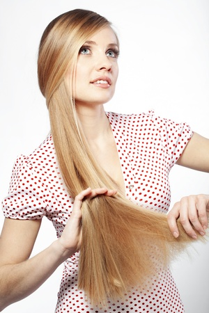 straight up: Portrait of young beautiful woman with long glossy blond hair