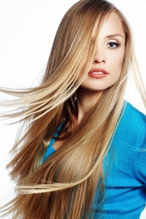 Portrait of young beautiful woman with long strong blond hair photo