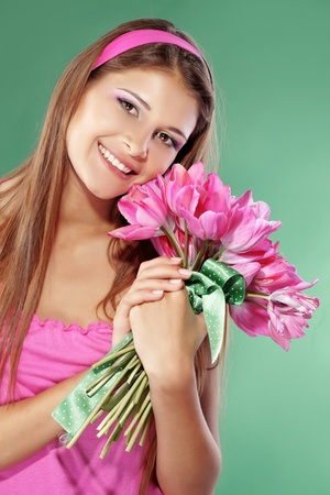 Beautiful girl with bunch of spring flowers