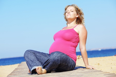 Portrait of beautiful pregnant woman at the beach photo