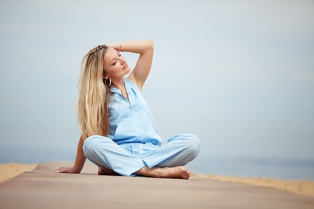 Middle aged woman resting at beach near the sea Stock Photo - 12935082