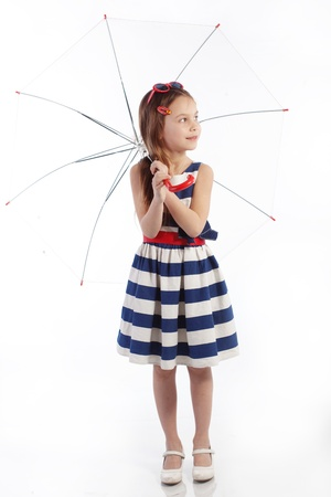 kids dress: Portrait of little pin-up fashion girl sea theme Stock Photo