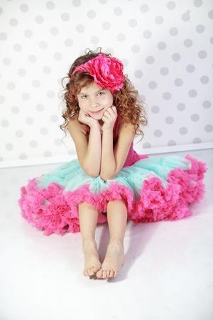 Studio portrait of cute little princess wearing beautiful tutu skirt photo