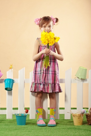 Studio portrait of cute kid girl Easter series photo