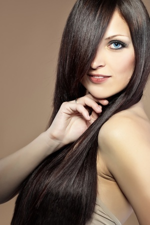 long hair brunette: Portrait of young beautiful woman with long glossy hair