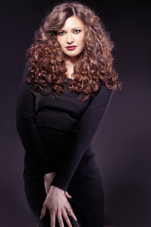 Portrait of young beautiful woman with long curly volume hair Stock Photo - 13041819