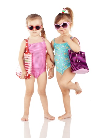child swimsuit: Studio series of cute fashion children wearing swimwear isolated on white background Stock Photo