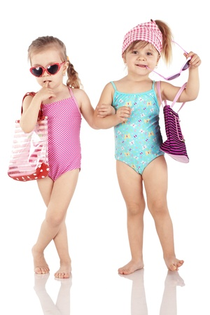 Studio series of cute fashion children wearing swimwear isolated on white background photo
