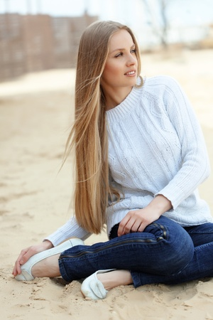 long straight hair: Beautiful young woman resting at the beach