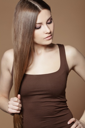 Portrait of young beautiful woman with long glossy hair photo
