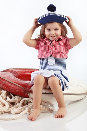sailor girl: Portrait of little pin-up fashion girl sea theme Stock Photo