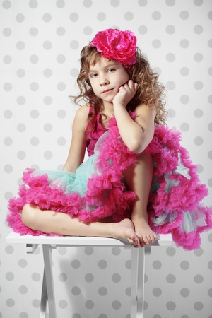 pink posing: Studio portrait of cute little princess wearing beautiful tutu skirt
