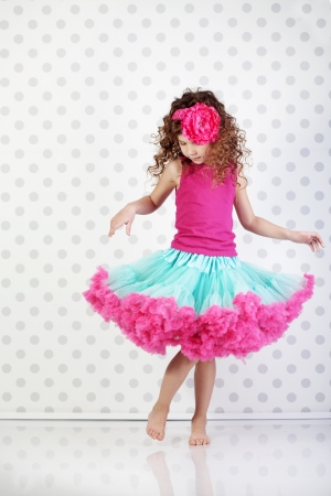 pretty dress: Studio portrait of cute little princess wearing beautiful tutu skirt
