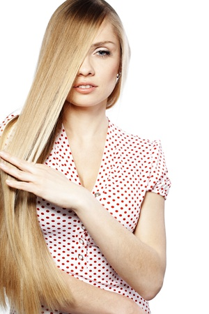 cute girl with long hair: Portrait of young beautiful woman with long glossy blond hair