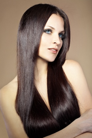 long hair model: Portrait of young beautiful woman with long glossy hair