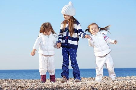 Kids having fun at the beach photo