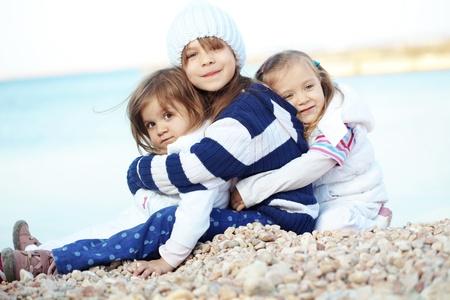 kids hugging: Kids having fun at the beach Stock Photo