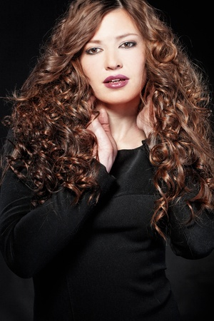 curly hair model: Portrait of young beautiful woman with long curly volume hair