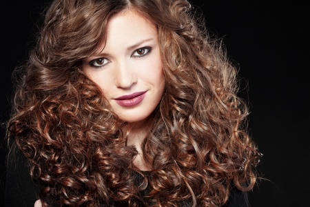hair black color: Portrait of young beautiful woman with long curly volume hair