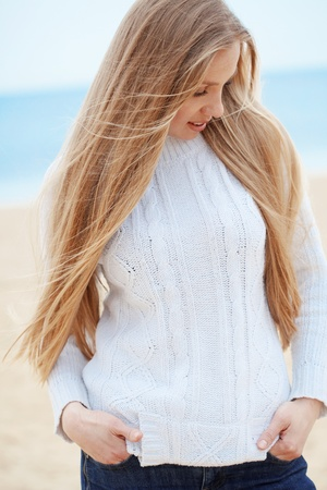 Beautiful young woman resting at the beach photo