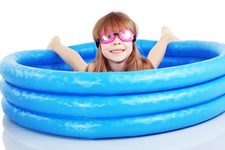 Child playing in swimming pool studio shot Stock Photo - 13258379