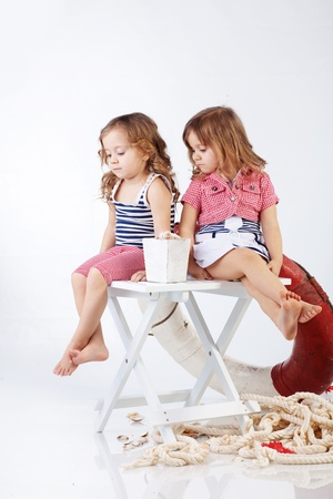 Studio portrait of children sea theme photo