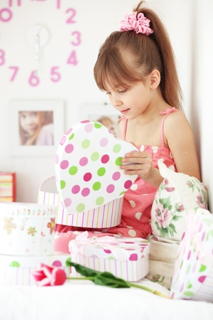 Photo of surprised girl with gifts photo