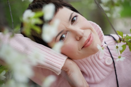 Portrait of beautiful middle aged woman in spring photo