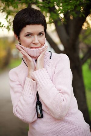 mature brunette: Portrait of beautiful middle aged woman in spring