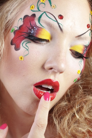 painted face: Stylish model with face paint Stock Photo