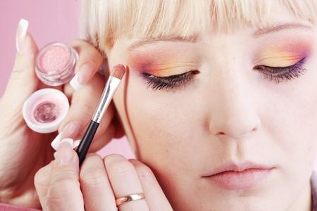 Studio series of doing fashion makeup photo