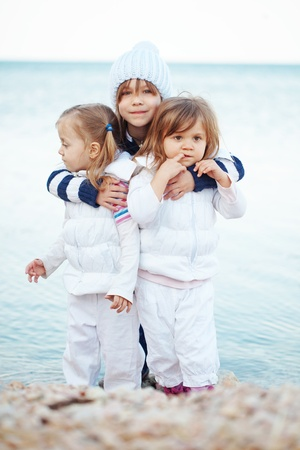 the three sisters: Kids having fun at the beach Stock Photo