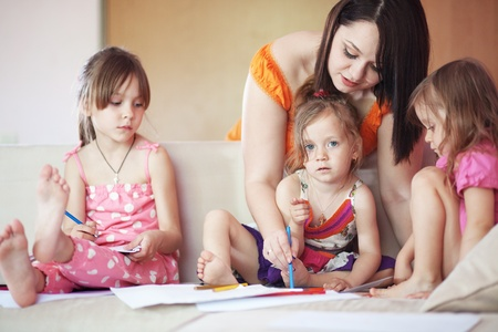 elementary age girl: Group of kids playing together with their mother at home