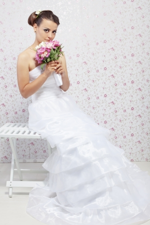 Beautiful young bride wearing fashion wedding dress photo