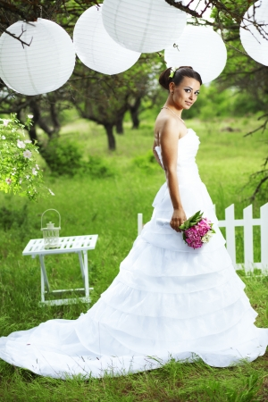 Portrait of beautiful bride outdoors photo