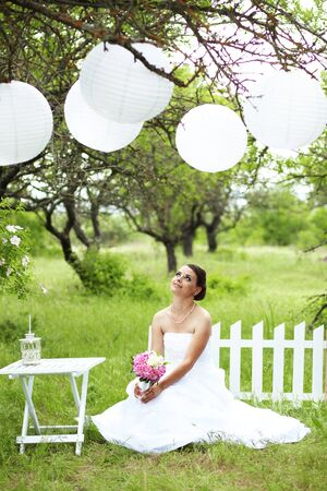 laterns: Portrait of beautiful bride outdoors