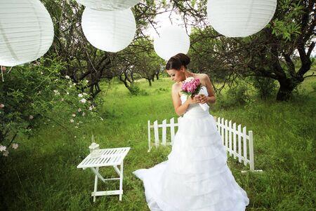 Portrait of beautiful bride outdoors photo