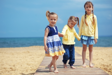 three children: Group of kids playing at the beach