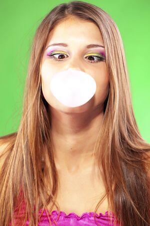 bubble gum: Girl blowing a big bubble gum bubble