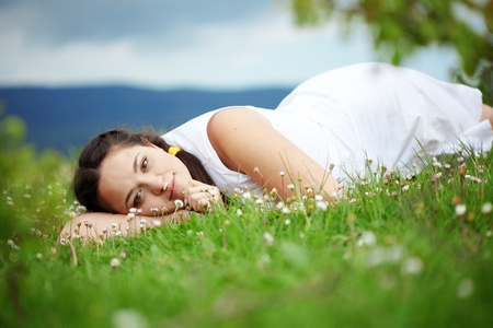 Portrait of woman resting outdoors photo