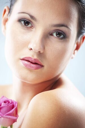 Studio portrait of sensual beautiful woman with rose photo