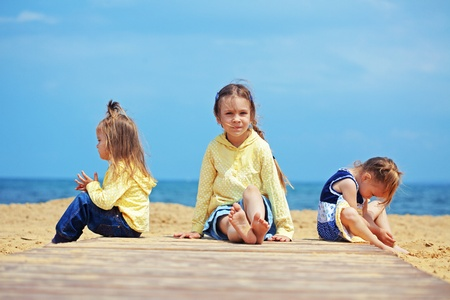 Group of kids playing at the beach photo